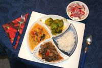 Indische Reistafel (Bara Jheenga Molee + Hare Gobhi Ki Sabzi + Saag Gosht)